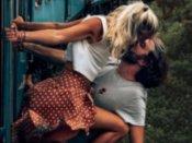 ઇન્સ્ટાગ્રામ ફોટો માટે કપલે પાર કરી બધી હદો, ચાલતી ટ્રેનમાં બહાર લટકીને કરી Kiss