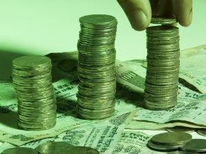 Rupee Trades Marginally Lower Line