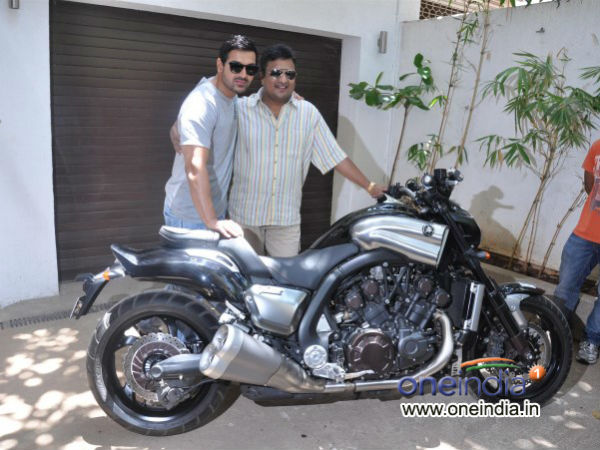 John Abraham Presents Motorcycle To Sanjay Gupta