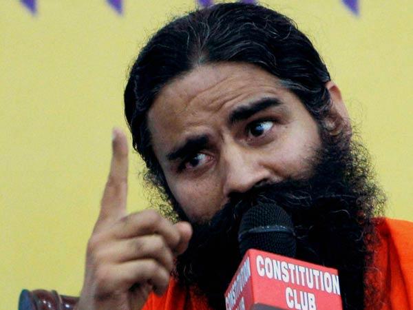 Ramdev Bats Narendra Modi Trains Gun At Nitish Kumar
