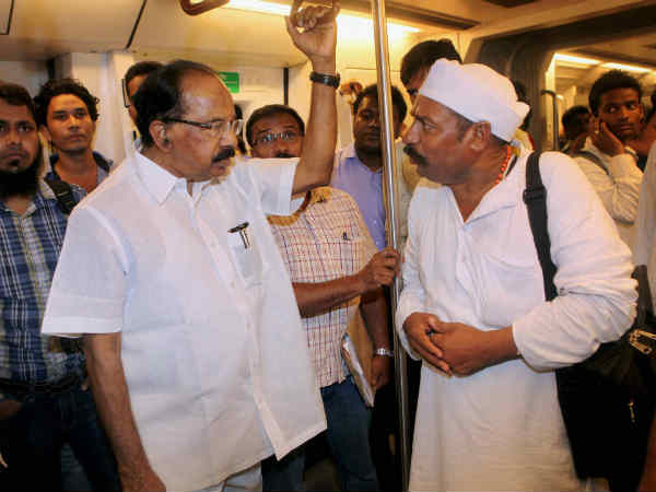 Petroleum Minister M Veerappa Moily Travels By A Metro Train