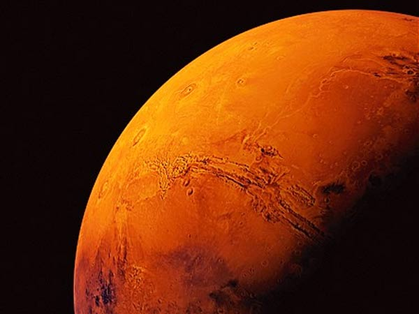 New Study Suggests Frozen Water Hidden Below Mars Surface