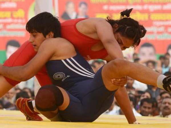 Wrestlers Assure Four Medals