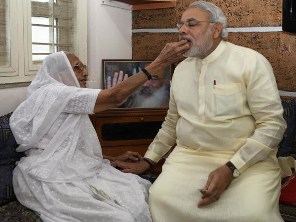 Modi S Mother Makes Laddoos His 64th Birthday