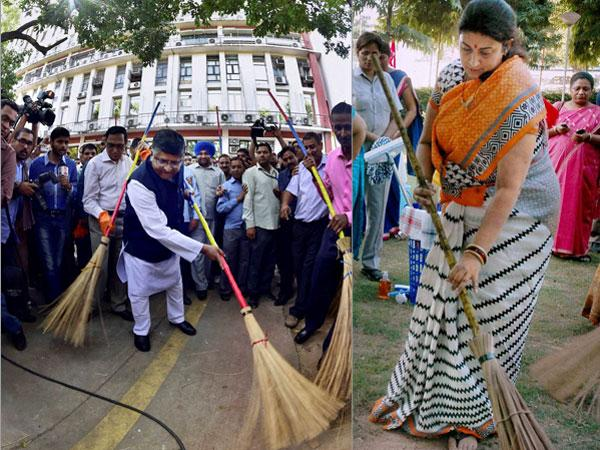 Ravi Shankar Prasad Smriti Irani Wield Broom India Follow