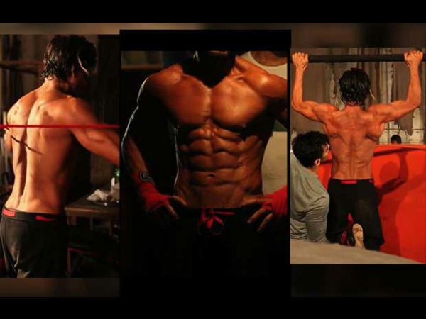 Watch Shahrukh Khan Bulking Up His Eight Pack Abs