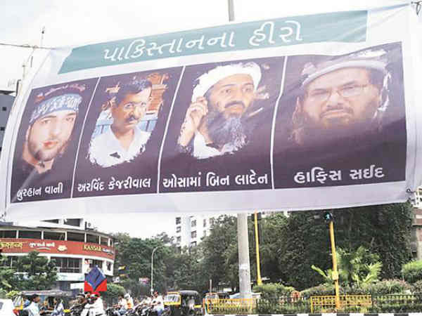 Ahead Of Arvind Kejriwal Surat Visit Banners Feature Him With Laden