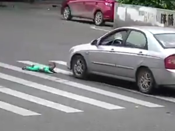 Terrifying Moment Child Almost Gets Run Over After Falling O