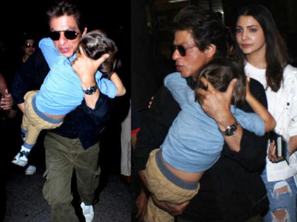 Shahrukh Khan Carries Sleepy Abram On Airport