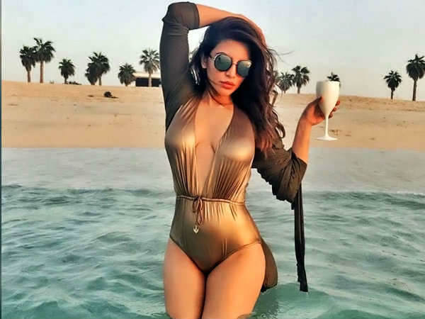 Shama Sikander S Dubai Trip Summed Up With Golden Swimsuit And White Shorts