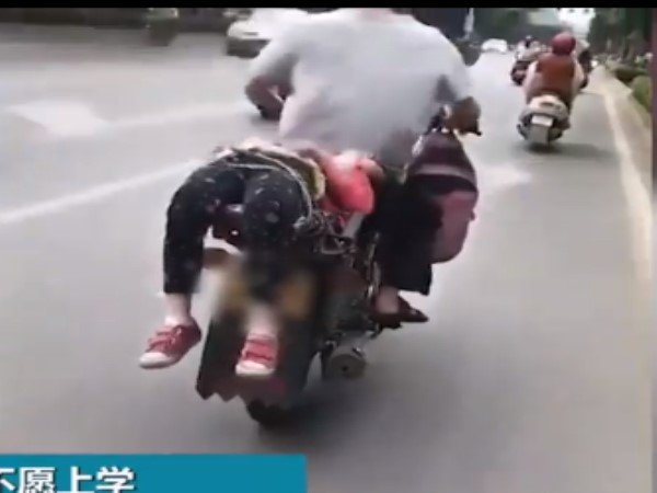 China Father Tied Her Daughter On Bike Left School