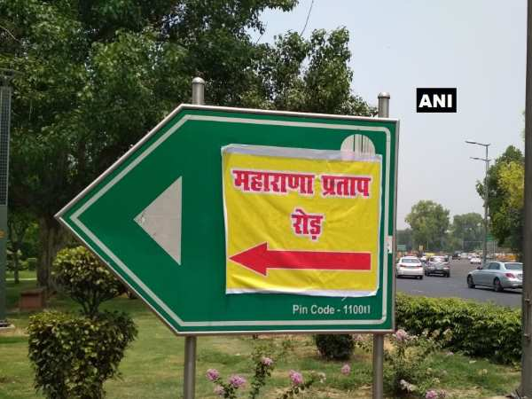 Delhi Poster With Maharana Pratap Road Written On It Pasted On Akbar Road Signboard
