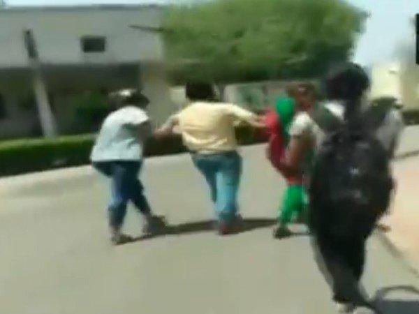 Punjab Patiala Girl Students Beat Up Professor Sending Obscene Messages