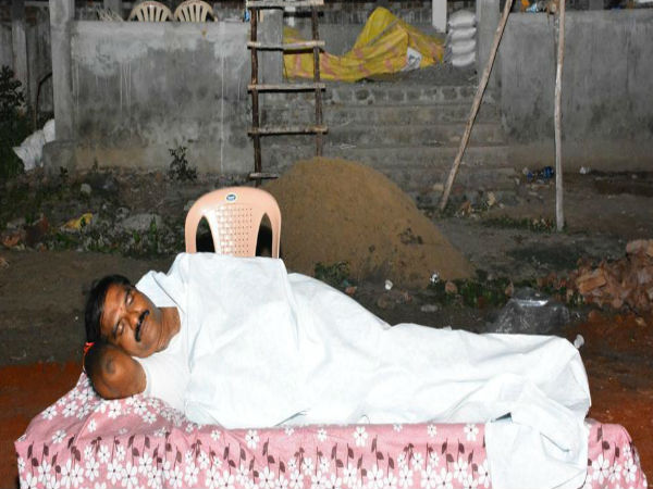 Video Tdp Mla Sleeps Crematorium Drive Away Fear Of Spirits Among Workers