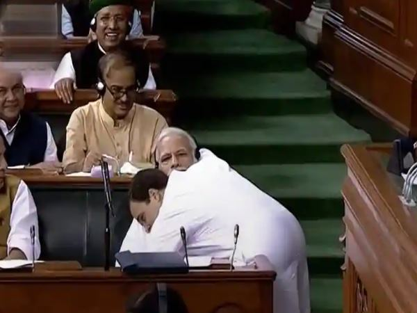 Congress Wished Hug Day Bjp Sharing Video Rahul Gandhi Hugging Modi