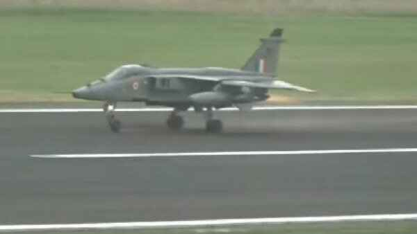 Video Indian Air Force Jet Jaguar Flies Into Birds Drops Fuel Tanks And Practice Bombs