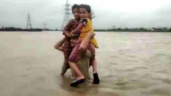 Gujarat Police Constable Carried Two Children On His Shoulders In Flood Waters