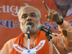 Narendra Modi Manmohan Singh Dahod Yuva Vikas Yatra