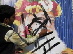 Man Blackens The Poster Asaram Bapu In Kumbh Mela