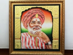 Cm Presented With His Portrait Made Crore Dots Through