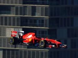 Flying Ferrari F1 Car Roars Sky