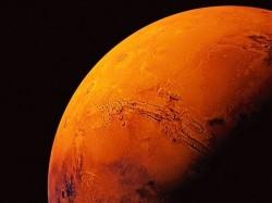 New Study Suggests Frozen Water Hidden Below Mars Surface