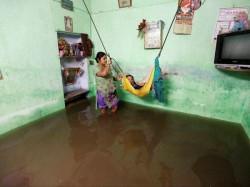 Photo Ahmedabad Sink In Heavy Rain Water Routine Disturb Schools Declared Holiday