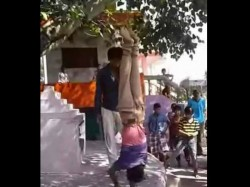 Shocking Video Boy Hung Upside Down Beaten With Stick As Punishment In Mp