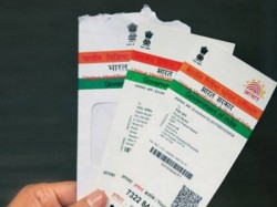 Government Decides To Link Savings Accounts With Aadhar Card For Digital Transactions