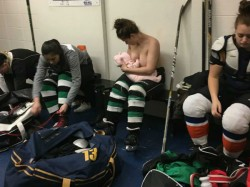 Hockey Player Breastfeeding Photograph In Dressing Room Breaks The Taboo