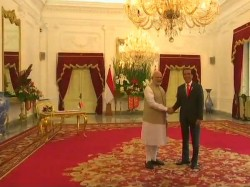Pm Narendra Modi Arrives At Merdeka Palace Welcomed Indonesian President Joko Widodo