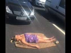 Girl Strips Off Sunbathes On The M62 While Stranded In Traffic Jam