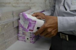 Rupee Gains Against Us Dollar Reaches Below 70 The First Time