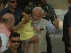 Pm Modi Votes In Ahmedabad Plays With Amit Shah S Granddaughter Crowd Cheers