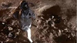 Man Pretend To Moon Walk As Astronaut On Ragged Rough Roads